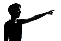 one caucasian young teenager silhouette boy or girl pointing surprised  portrait in studio cut out isolated on white background