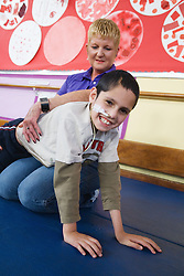 Boy with cerebral palsy doing exercises