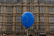 A blue European Union ballon outside Houses of Parliament on the first day after summer recess on 3rd September 2019 in London in the United Kingdom. MPs return to Westminster for a Brexit shutdown that could result in a general election.