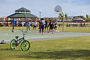 Boys Playing Basketball at Mossdale Landing Community Park