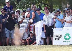 September 24, 2017 - Atlanta, GA, USA - Brooks Koepka hits his second shot on the 1st hole beside a trash box off the first fairway during the final round of the Tour Championship at East Lake Golf Club in Atlanta on Sunday, Sept. 24, 2017. (Credit Image: © Curtis Compton/TNS via ZUMA Wire)