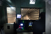 A conductor sits in the control room of a subway train in Beijing, China, on Tuesday, Dec. 01, 2015.