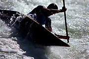 Silhouette of kayaker in action