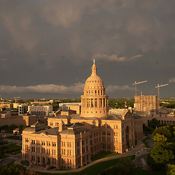 A cloud bank forms over the Texas Capitol dome in Austin while a spring weather system blows through central Texas. The mammatocumulus are characterized by cotton-like puffiness and dramatic formations.