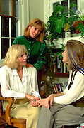 Mother age 58 chatting with daughters ages 23 and 26.  Minneapolis Minnesota USA