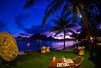 Outdoor dining on the lagoon, Four Seasons Resort Bora Bora, French Polynesia.