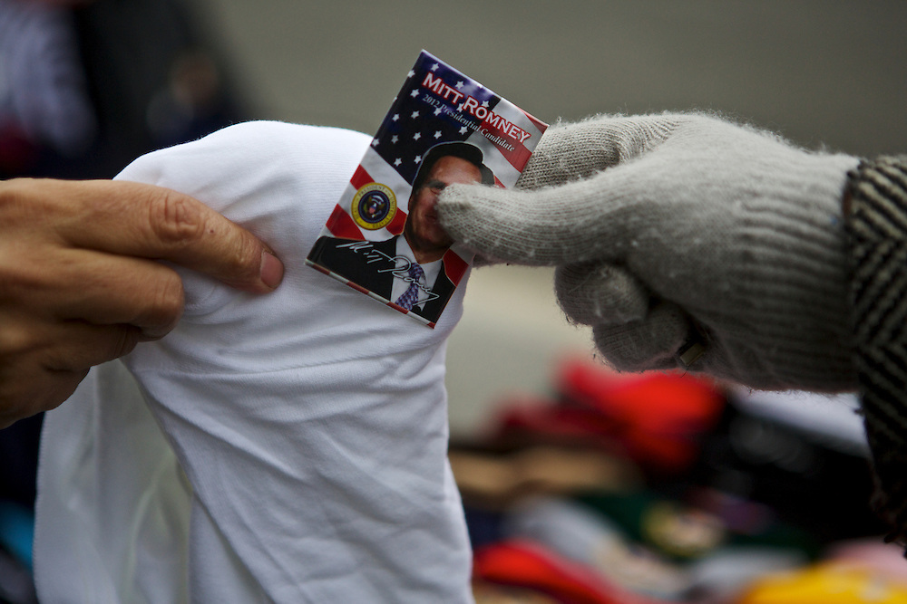 A Mitt Romney supporter from Germantown, Md., purchases leftover election memorabilia from a street vendor near the White House on Nov. 7, 2012 in Washingont, D.C.