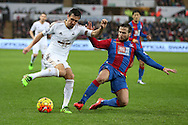 Jack Cork of Swansea city (l) is tackled by Yohan Cabaye of Crystal Palace. Barclays Premier league match, Swansea city v Crystal Palace at the Liberty Stadium in Swansea, South Wales on Saturday 6th February 2016.<br /> pic by Andrew Orchard, Andrew Orchard sports photography.