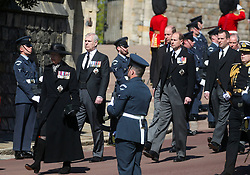 (Left to right) Princess Anne, the Duke of York, Peter Phillips, the Duke of Cambridge, the Earl of Wessex and Peter Phillips walking in the procession to St George's Chapel, Windsor Castle, Berkshire, for the funeral of the Duke of Edinburgh. Picture date: Saturday April 17, 2021. PA Photo. See PA story FUNERAL Philip. Photo credit should read: Steve Parsons/PA Wire