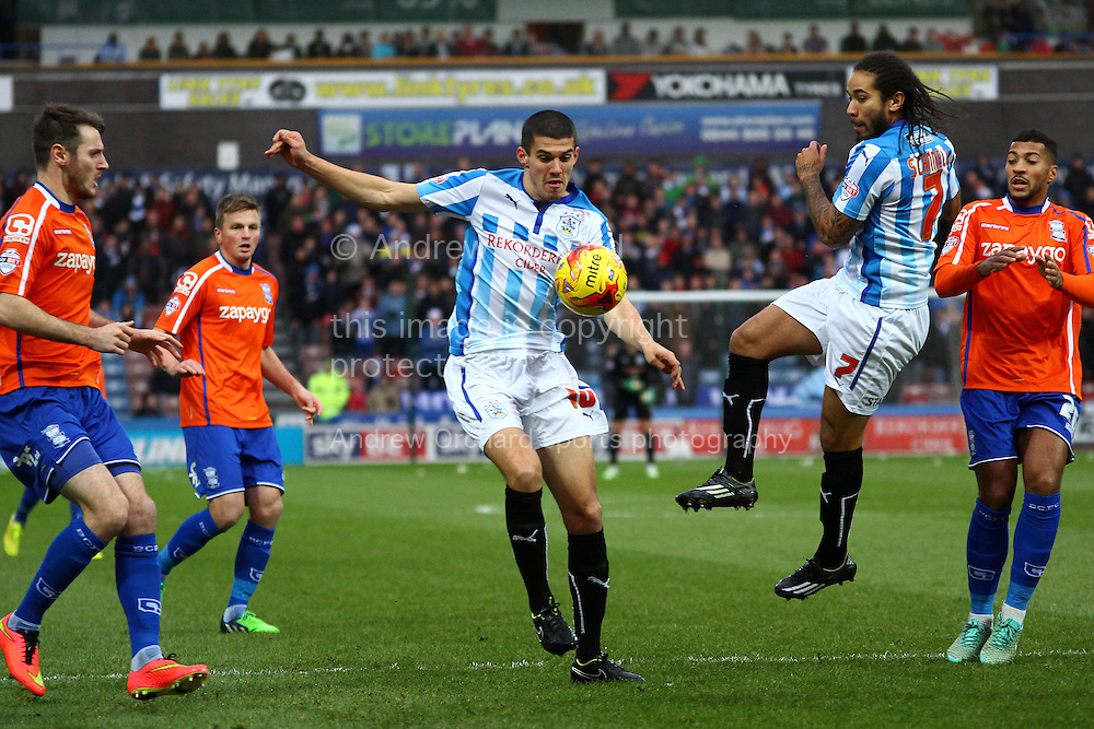 Conor Coady of Huddersfield Town looks to control the ball. Skybet football league championship match, Huddersfield Town v Birmingham city at the John Smith's stadium in Huddersfield, Yorkshire on Saturday 20th December 2014.<br /> pic by Chris Stading, Andrew Orchard sports photography.