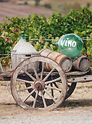 Wine bottles on a handcart, Val d'Orcia, Tuscany, Italy