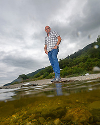 Alan Wright at the small beach on the Loch where it happened. He was involved in the with the emergency services on Loch Lomond and  took paramedics on his boat to try and rescue the boy who drowned on Sunday.