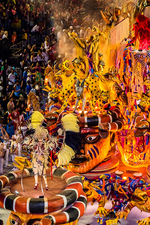 Performers on floats in the Carnaval parade of Grande Rio samba school in the Sambadrome, Rio de Janeiro, Brazil.