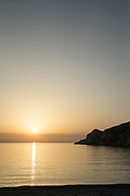 Sunset over tranquil Aegean Sea seen from island of Chios, Greece