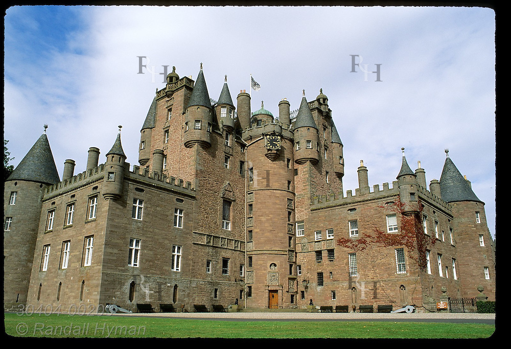 Wide-angle, frontal view of Glamis Castle, childhood home of Queen Mother & setting for the play Macbeth; Glamis, Scotland