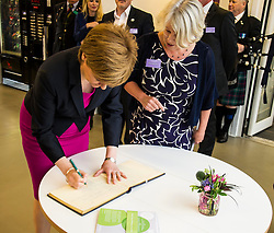 Pictured: Nicola Sturgeon signs the visitors book to officially open the centre.<br /> <br /> The First Minister Nicola Sturgeon, MSP, joined people supported by the Thistle Foundation to bury a time capsule to mark the opening of a new health and social care centre. <br /> Ger Harley | EEm 14 June 2016