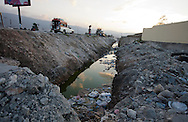Polluted water in Port-au-Prince, Haiti full of garbage. Haiti has little sanitation which is a factor in the spreading of the cholera epidemic.