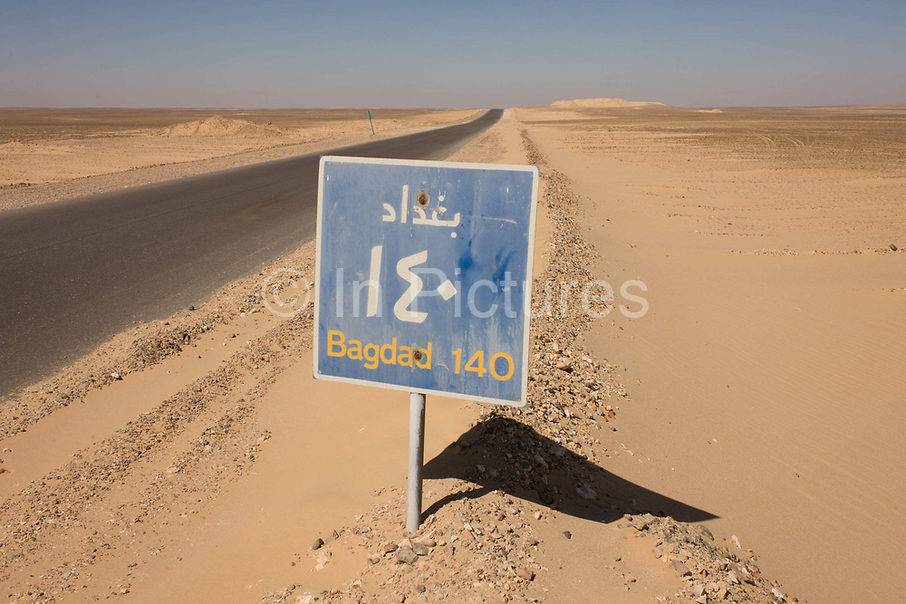 A desert highway road sign for the Egyptian town of Bagdad (not to be confused with Baghdad, Iraq) between Luxor and al-Kharga, Western Desert, Egypt. The Western Desert covers an area of some 700,000 km2, thereby accounting for around two-thirds of Egypt's total land area. Dakhla Oasis is one of the seven oases of Egypt's Western Desert (part of the Libyan Desert). It lies in the New Valley Governorate, 350 km (220 mi.) and measures approximately 80 km (50 mi) from east to west and 25 km (16 mi) from north to south.