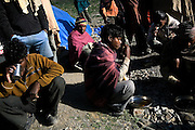 Labourers are having breakfast near their tents along the Leh-Manali Highway.