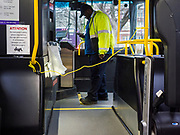 """24 MARCH 2020 - DES MOINES, IOWA: A bus driver gets on a Des Moines Area Regional Transit (DART) bus Tuesday. There were no passengers on the bus because many Des Moines residents are heeding a suggestion by the Mayor to shelter in place. On Tuesday morning, 24 March, Iowa reported over 120 confirmed cases of the Coronavirus (SARS-CoV-2) and COVID-19. Restaurants, bars, movie theaters, places that draw crowds are closed for at least 30 days. The Governor has not ordered """"shelter in place""""  but several Mayors, including the Mayor of Des Moines, have asked residents to stay in their homes for all but the essential needs. People are being encouraged to practice """"social distancing"""" and many businesses are requiring or encouraging employees to telecommute.       PHOTO BY JACK KURTZ"""