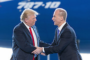 U.S. President Donald Trump is welcome by Boeing CEO Dennis Muilenburg as he arrives for the debut of the new Boeing 787-10 Dreamliner aircraft at the Boeing factory February 17, 2016 in North Charleston, SC. The visit comes two days after workers at the South Carolina plant voted to reject union representation in a state where Trump won handily.
