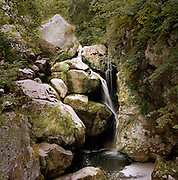 A waterfall trickling through countryside of Picos de Europa (the Peaks of Europe) in the Asturias, Spain