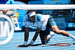 16.01.2014, Melbourne Park Tennis Cente, Melbourne, AUS, Australian Open 2014, Herren Einzel, Tag 4, im Bild Jo-Wilfried Tsonga of France falls on the court during the men's singles 2nd round match against Thomaz Bellucci of Brazil // on day four of the 2014 Australian Open tennis tournament at the Melbourne Park Tennis Center, Australia on 2014/01/16. EXPA Pictures © 2014, PhotoCredit: EXPA/ Photoshot/ Jin Linpeng<br /> <br /> *****ATTENTION - for AUT, SLO, CRO, SRB, BIH, MAZ only*****