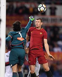 ROME, April 19, 2018  Genoa's goalkeeper Mattia Perin (L) competes with Roma's Edin Dzeko during a Serie A soccer match between Roma and Genoa in Rome, Italy, April 18, 2018. Roma won 2-1. (Credit Image: © Alberto Lingria/Xinhua via ZUMA Wire)