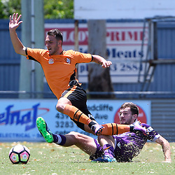 BRISBANE, AUSTRALIA - JANUARY 8: Nicholas Panetta of the Roar is tackled by Jack Iredale of the Glory during the round 8 Foxtel National Youth League match between the Brisbane Roar and Perth Glory at AJ Kelly Field on January 8, 2017 in Brisbane, Australia. (Photo by Patrick Kearney/Brisbane Roar)