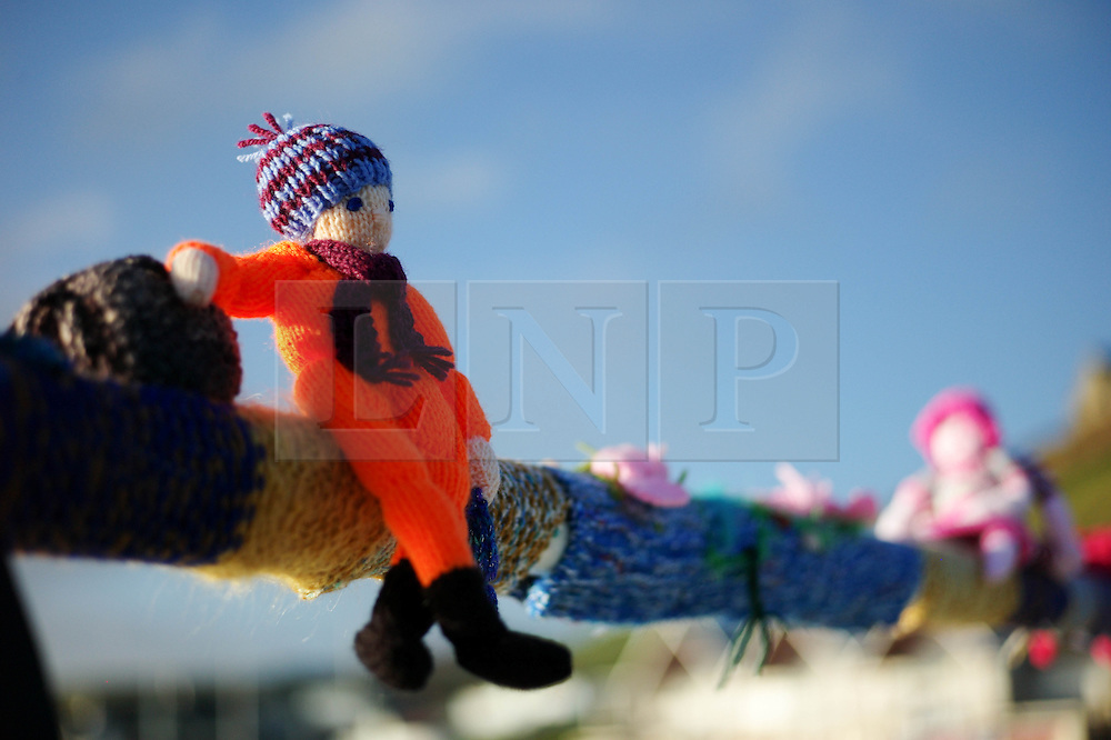 Once again the mysterious group of Saltburn knitters have been working their magic and have produced another amazing display of local seaside scenes created out of wool and attached to the Victorian Pier in Saltburn by the Sea, Cleveland..© Licensed to London News Pictures. 25/05/2013..Saltburn, England..Once again the mysterious group of knitters in Saltburn by the Sea in Cleveland have been working their magic and have produced another amazing display of local seaside scenes created out of wool and attached to the Victorian Pier in the town...The woollen figures first appeared last year to mark the Olympics and then the royal wedding and created a storm of interest in the figures and brought many visitors into the town...Photo credit : Ian Forsyth/LNP