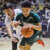 Tuba City Warrior Terrell Arizona (10) fights the ball away from Page Sand Devil Justin Billy (25) Saturday at the Chinle Wildcat Den.
