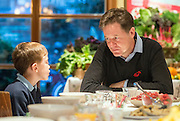 © Licensed to London News Pictures. 03/11/2014. Oxford, UK. NICK CLEGG talks with local schoolboy Hugo Stone aged 7.  To celebrate National School Meals Week (3-7 November), the Deputy Prime Minister, Nick Clegg, joins school children at Brasserie Blanc in Oxford to get some top cooking tips from Raymond Blanc. The visit is part of a larger national effort to raise awareness of and enhance children's relationship with food. The Deputy Prime Minister has called on celebrity chefs to lead the way by joining forces with school cooks to promote the great school lunch. School cooks up and down the country will be taking their skills out of the school kitchen to showcase to parents and pupils the variety and quality of food now being served in schools. National School Meals Week comes just months after the launch of free school meals for 2.8 million primary school children and the introduction of cooking in the curriculum.. Photo credit : Stephen Simpson/LNP