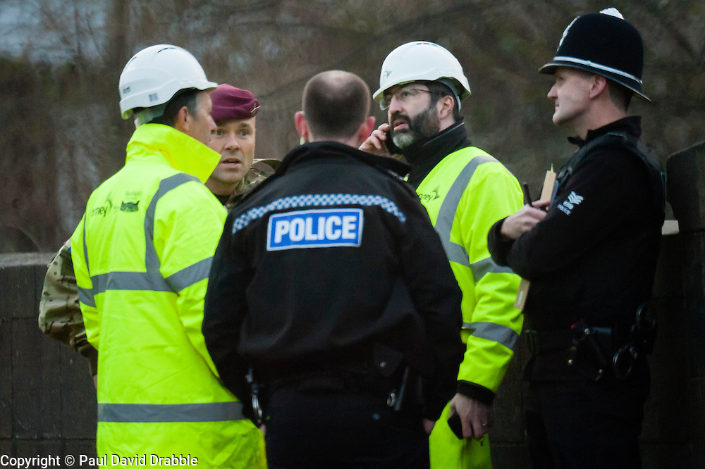 The British Army Bomb Squad were called in and police closed Leppings lane a road behind Sheffield Wednesday Football Ground on Tuesday march 5th 2017. Council workers carrying out clearance work on the Banks of the River Don discovered what they believed might be an unexploded second world war bomb dropped on the city during the Bitz<br /> A member of the Bomb Disposal Team breaks the news to Police and Council officials that the UXB was a false alarm. <br /> 5 March  2013<br /> Image © Paul David Drabble<br /> www.pauldaviddrabble.co.uk