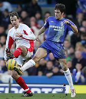 Photo: Lee Earle.<br /> Chelsea v Birmingham City. The Barclays Premiership.<br /> 31/12/2005.<br /> City's Stephen Clemence (L)  battles with Joe Cole.