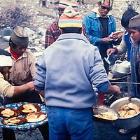 A sherpa crew and his staff prepare breakfast for trekkers hiking around Annapurna in Nepal.