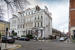 """The Phillimore Gardens building housing the AirBNB £2.5m five-bedroom flat, right, home of American divorcee Elizabeth Sterling where an AirBnB booking for a """"hen party for eight"""" turned into a wild party with dozens of revellers. Kensington, London, January 27 2019."""