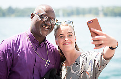"1 July 2018, Geneva, Switzerland: ÁRNADÓTTIR, Ms Thuridur Björg Wiium, The Evangelical Lutheran Church of Iceland (ICELAND) takes photo with LWF president Archbishop Musa Panti Filibus. Following Sunday service at the Evangelical Lutheran Church in Geneva, LWF Council members journeyed from Geneva to Nyon by boat across Lake Geneva. The 2018 LWF Council meeting takes place in Geneva from 27 June - 2 July. The theme of the Council  is ""Freely you have received, freely give"" (Matthew 10:8, NIV). The LWF Council meets yearly and is the highest authority of the LWF between assemblies. It consists of the President, the Chairperson of the Finance Committee, and 48 members from LWF member churches in seven regions."