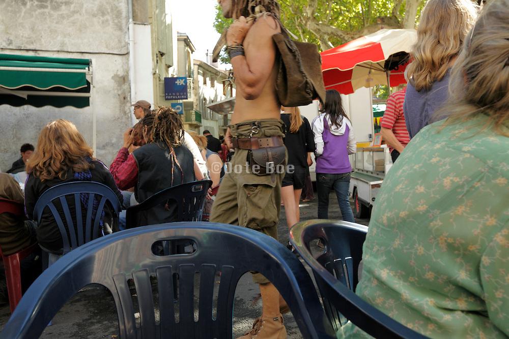 bare breasted rastafarian casual walking