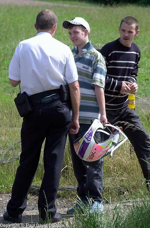 PC Peter booth speaks to two young men walking accross Westwood Country Park during Police operation against illegal off road biking in the High Green area Sunday <br /><br />Image Copyright Paul David Drabble<br /><br />29 June 2003<br /><br />Copyright  Paul David Drabble<br /><br />[#Beginning of Shooting Data Section]<br />Nikon D1 <br /><br />2003/06/29 10:30:40.1<br /><br />JPEG (8-bit) Fine<br /><br />Image Size:  2000 x 1312<br /><br />Color<br /><br />Lens: 80-200mm f/2.8-2.8<br /><br />Focal Length: 135mm<br /><br />Exposure Mode: Programmed Auto<br /><br />Metering Mode: Multi-Pattern<br /><br />1/250
