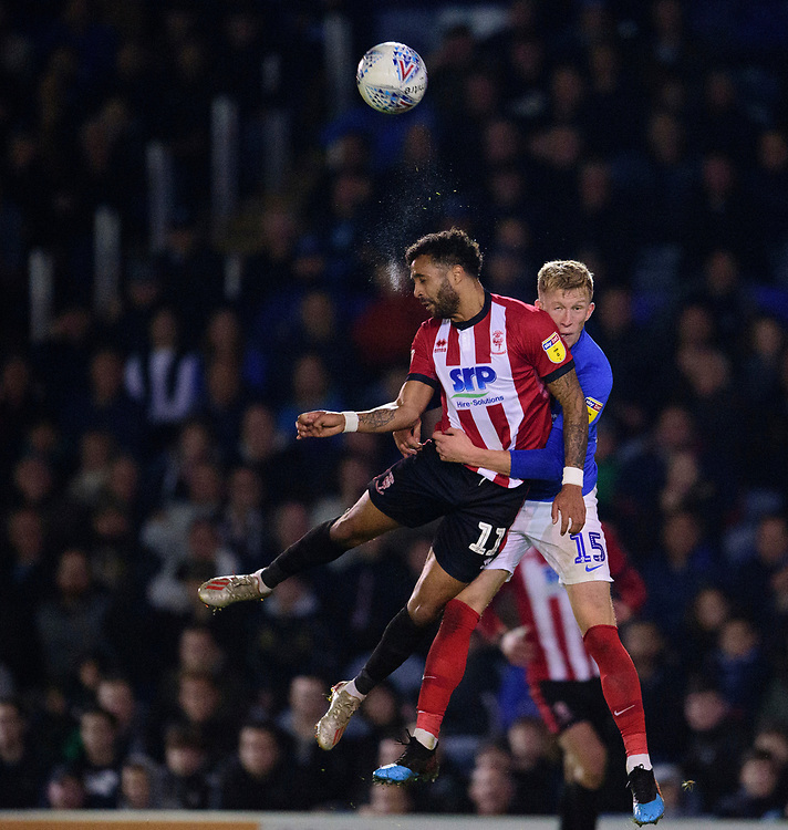 Lincoln City's Bruno Andrade battles with Portsmouth's Ross McCrorie<br /> <br /> Photographer Andrew Vaughan/CameraSport<br /> <br /> The EFL Sky Bet League One - Portsmouth v Lincoln City - Tuesday 22nd October 2019 - Fratton Park - Portsmouth<br /> <br /> World Copyright © 2019 CameraSport. All rights reserved. 43 Linden Ave. Countesthorpe. Leicester. England. LE8 5PG - Tel: +44 (0) 116 277 4147 - admin@camerasport.com - www.camerasport.com