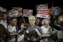 July 29, 2017 - Istanbul, Turkey - Cumhuriyet Newspaper  journalist MUSA KART and BULENT UTKU greet media. A Turkish court has released seven jailed newspaper staff pending the end of their terrorism trial. At least four others will remain behind bars. (Credit Image: © Depo Photos via ZUMA Wire)