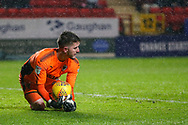 AFC Wimbledon goalkeeper Joe McDonnell (24) saves a shot from Charlton Athletic midfielder Ben Reeves (12) (not in the picture) during the EFL Sky Bet League 1 match between Charlton Athletic and AFC Wimbledon at The Valley, London, England on 15 December 2018.