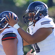 Orange County, California, USA: Fullerton College defenders celebrate in the fourth quarter. (Eric Cech/Sports Shooter Academy)
