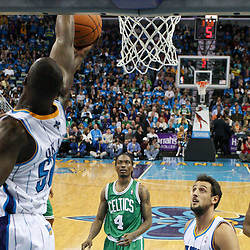 December 28, 2011; New Orleans, LA, USA; New Orleans Hornets center Emeka Okafor (50) blocks a shot by Boston Celtics power forward Kevin Garnett (5) during the fourth quarter of a game at the New Orleans Arena. The Hornets defeated the Celtics 97-78.  Mandatory Credit: Derick E. Hingle-US PRESSWIRE