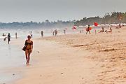 Apr 24 - KUTA, BALI - Tourists on Kuta beach, one of Bali's most famous beaches in Kuta, Bali, Indonesia. Photo by Jack Kurtz/ZUMA Press