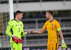 HELSINKI, FINLAND - Thursday, September 3, 2020: Wales' goalkeeper Wayne Hennessey (L) and Finland's goalkeeper Lukáš Hrádecký at the final whistle during the UEFA Nations League Group Stage League B Group 4 match between Finland and Wales at the Helsingin Olympiastadion. Wales won 1-0. (Pic by Jussi Eskola/Propaganda)