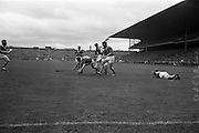 06/09/1964<br /> 09/06/1964<br /> 6 September 1964<br /> All-Ireland Senior Final: Tipperary v Kilkenny at Croke Park, Dublin.<br /> D. Nealon (Tipperary forward) got the ball away from the Kilkenny blockade, but was foiled by the Kilkenny golie.