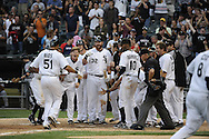 CHICAGO - SEPTEMBER 10:  Teammates greet Alex Rios #51 of the Chicago White Sox at home plate after Rios hit a walk-off grand slam home run in the bottom of the tenth inning off of Chris Perez #54 of the Cleveland Indians on September 10, 2011 at U.S. Cellular Field in Chicago, Illinois.  The White Sox defeated the Indians 7-3.  (Photo by Ron Vesely)   Subject: Alex Rios;Chris Perez