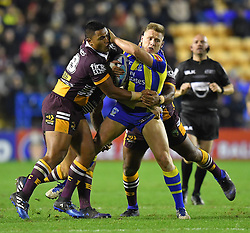 Warrington Wolves' Brad Dwyer  is tackled during the 2017 Dacia World Club Series match at the Halliwell Jones Stadium, Warrington. PRESS ASSOCIATION Photo. Picture date: Saturday February 18, 2017. See PA story RUGBYL Warrington. Photo credit should read: Dave Howarth/PA Wire. RESTRICTIONS: Editorial use only. No commercial use. No false commercial association. No video emulation. No manipulation of images.