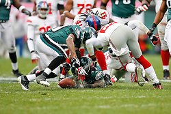 Philadelphia Eagles and New York Giants battle for a loose ball during the NFL game between the New York Giants and the Philadelphia Eagles on November 1st 2009. The Eagles won 40 to 17 at Lincoln Financial Field in Philadelphia, Pennsylvania. (Photo By Brian Garfinkel)